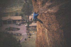 Man climbing cliff